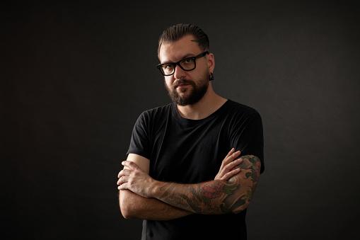 studio portrait of a bearded man wearing glasses on a black background - gettyimageskorea
