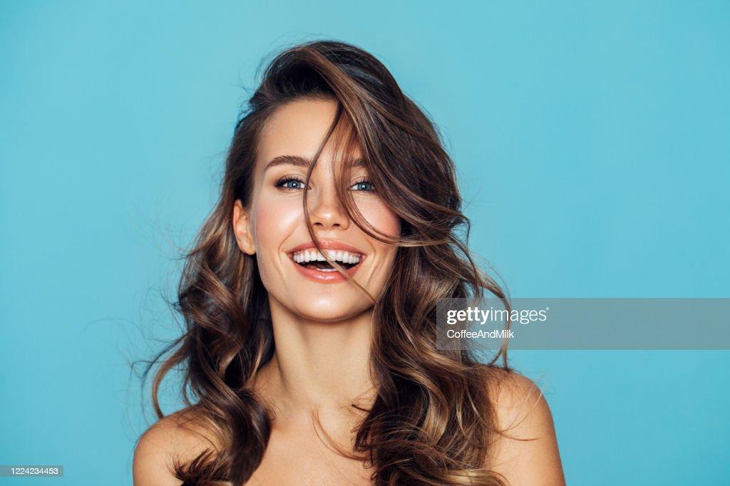 Studio portrait of a beautiful girl : Stock Photo