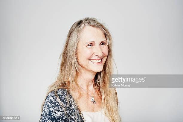 A studio portrait of a cool older woman smiling