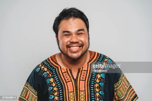 Studio portrait of a funny malaysian man