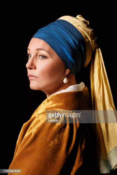 studio portrait of a girl with a pearl earring - renaissance stock pictures, royalty-free photos & images