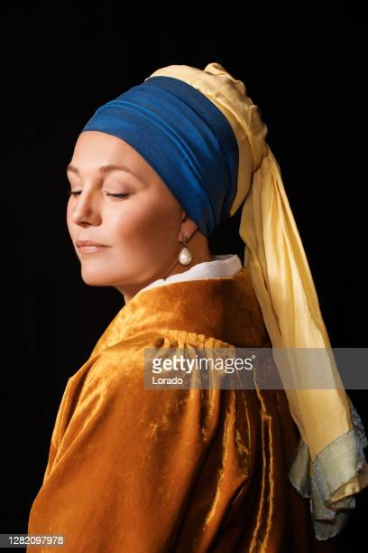 studio portrait of a girl with a pearl earring - pearl earring stock pictures, royalty-free photos & images