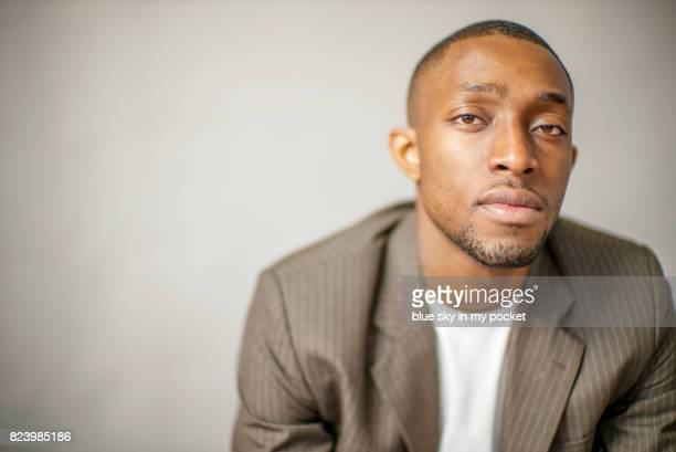 studio portrait of a handsome man. - brown blazer stock photos and pictures