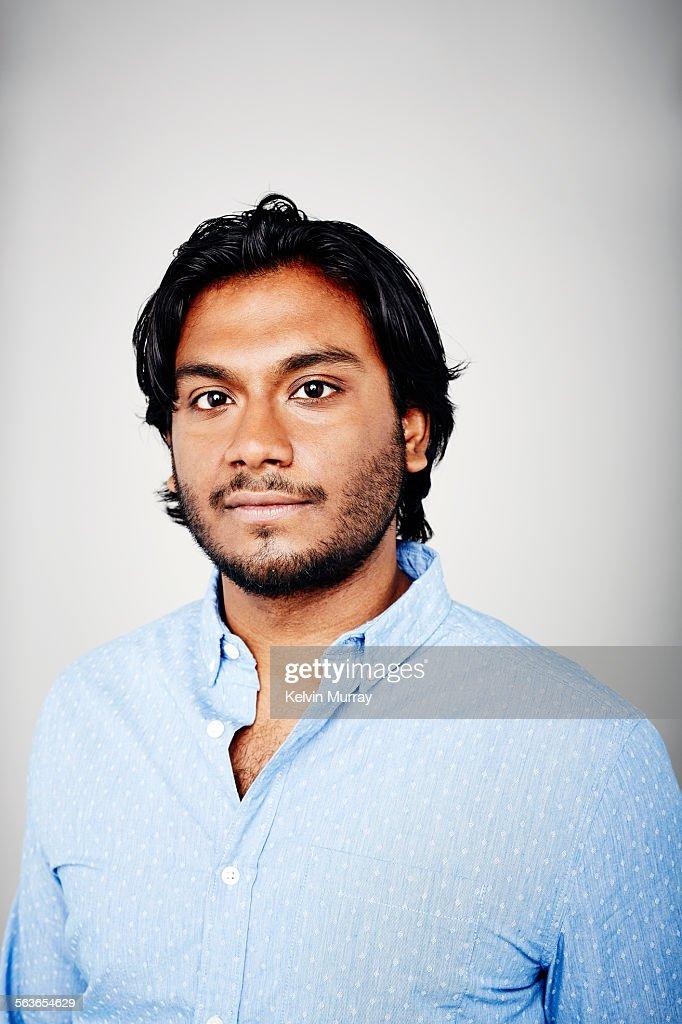 Studio portrait of a man wearing a blue shirt : Stock Photo
