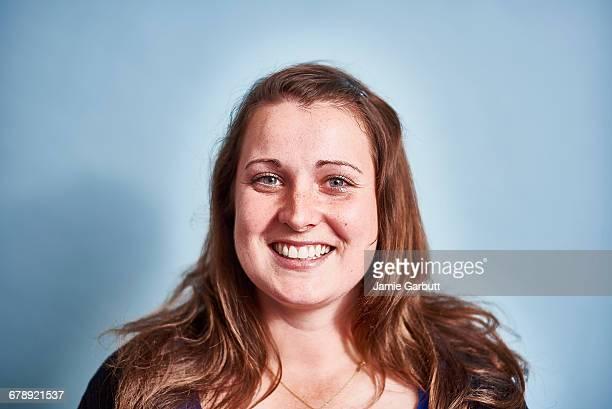 A studio portrait of a mid 20's British female
