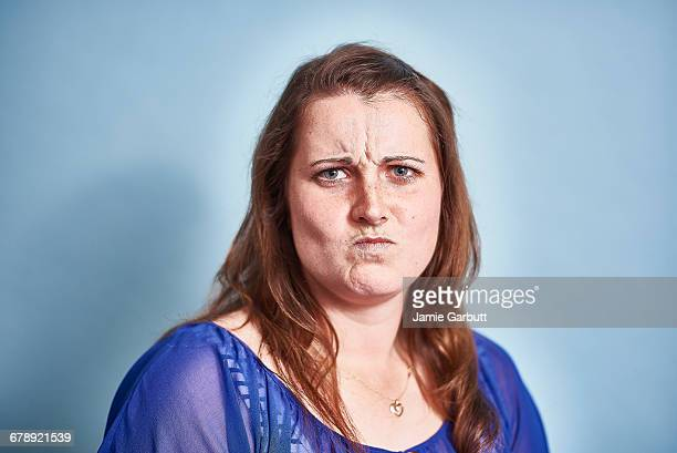 a studio portrait of a mid 20's british female - sulking stock pictures, royalty-free photos & images