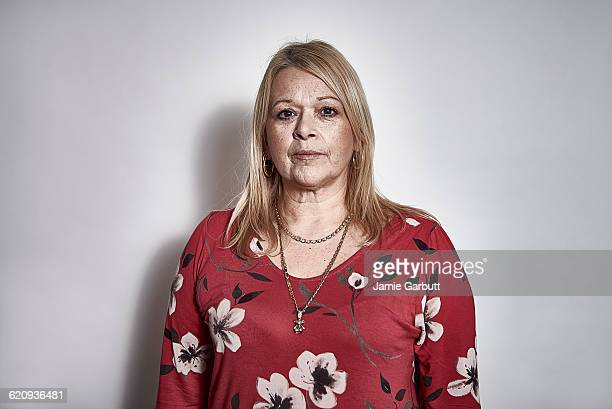 studio portrait of a middle aged women - serious stock pictures, royalty-free photos & images