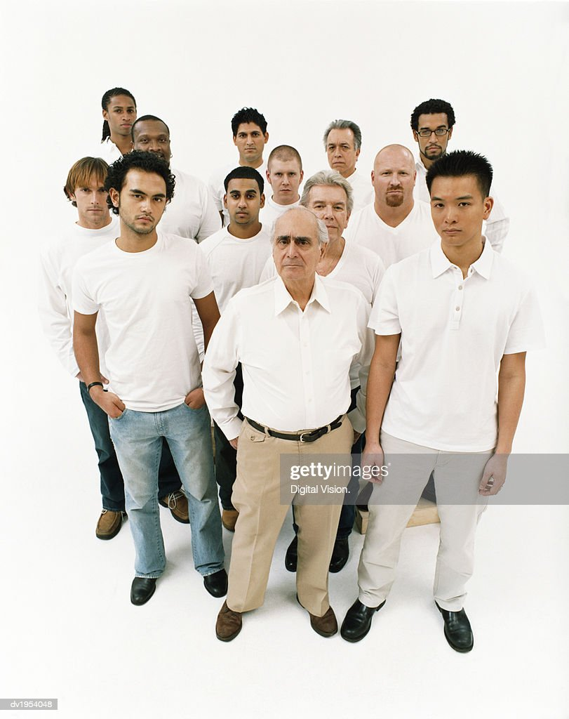 Studio Portrait of a Mixed Age, Multiethnic, Large Group of Displeased Men Wearing White Tops : Stock Photo