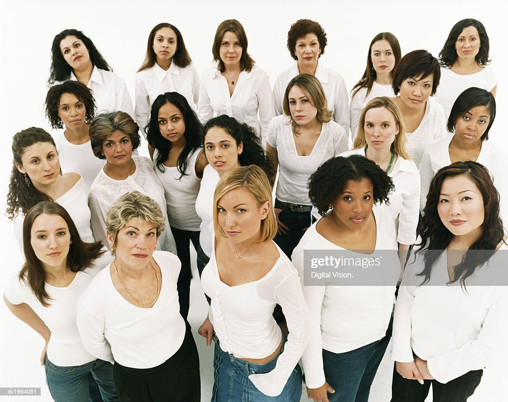 Studio Portrait of a Mixed Age, Multiethnic, Large Group of Displeased Women Wearing White Tops : Stock Photo
