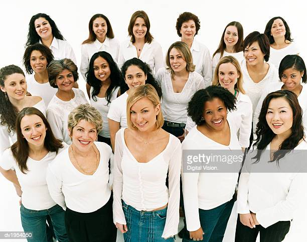 studio portrait of a mixed age, multiethnic, large group of happy women wearing white tops - grupo grande de pessoas - fotografias e filmes do acervo