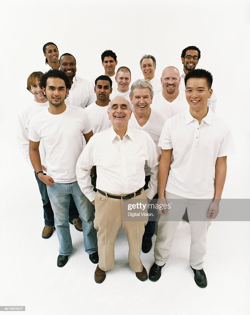 Studio Portrait of a Mixed Age, Multiethnic, Large Group of Smiling Men Wearing White Tops : Stock Photo