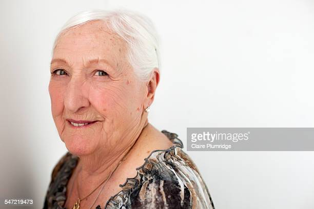 studio portrait of a ninety year old woman - claire plumridge stock pictures, royalty-free photos & images