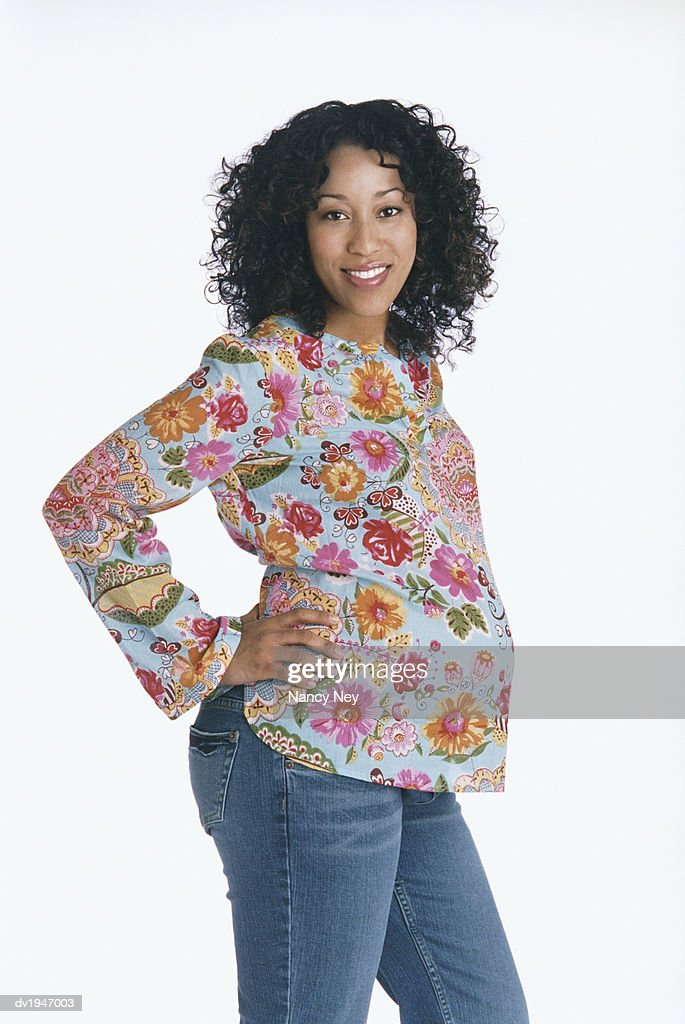 Studio Portrait of a Pregnant Woman in a Floral Top : Stock Photo