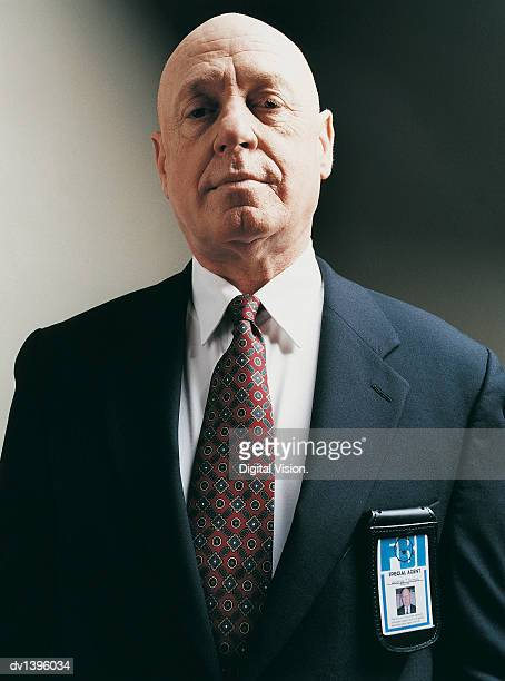studio portrait of a special agent with an id badge - fbi id stock pictures, royalty-free photos & images