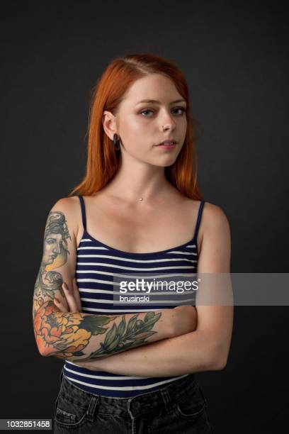 studio portrait of a tattoo artist on a black background - 20 24 years stock pictures, royalty-free photos & images