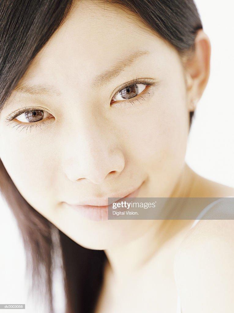 Studio Portrait of a Woman Looking Over Her Shoulder : Stock Photo