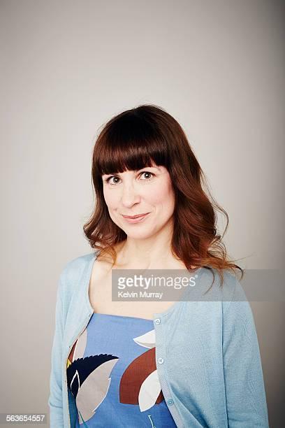 a studio portrait of a woman smiling - 前髪 ストックフォトと画像