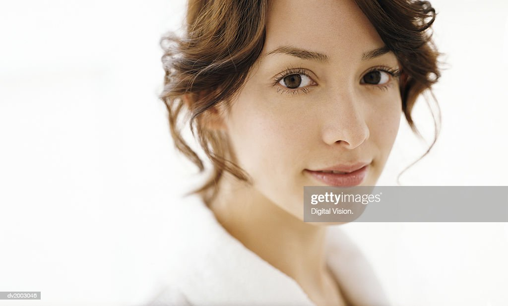 Studio Portrait of a Woman Wearing a White Bathrobe : Stock Photo