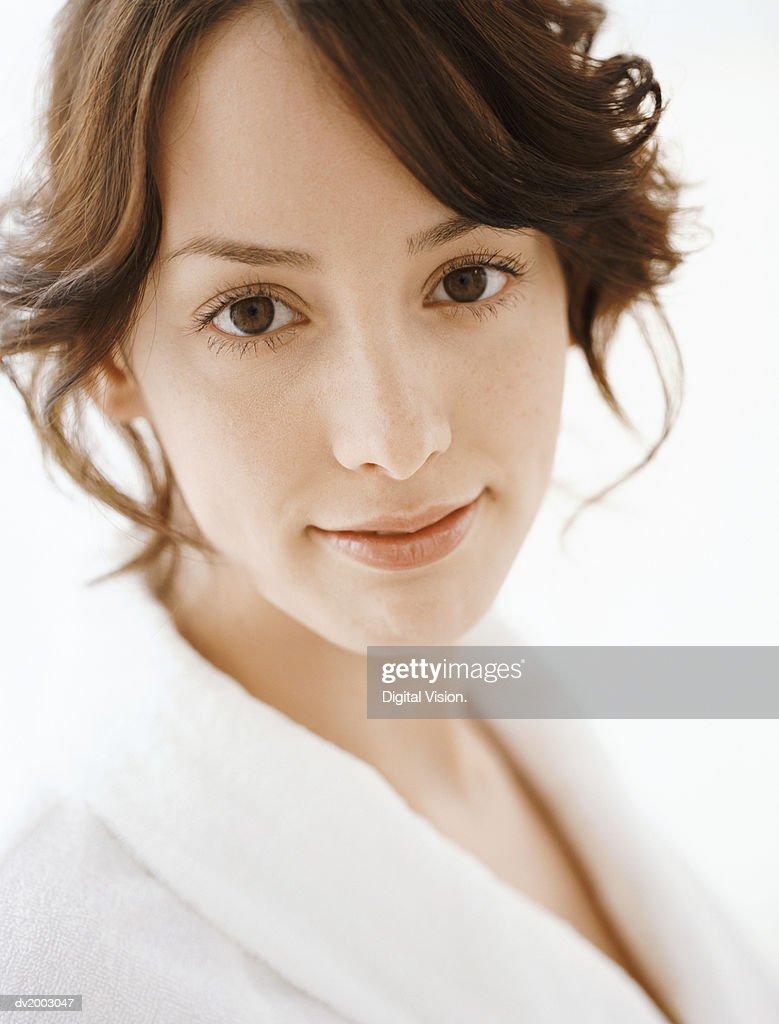 Studio Portrait of a Woman Wearing a White Bathrobe : Stock Photo