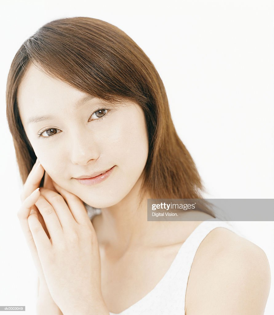 Studio Portrait of a Woman Wearing a White Vest : Stock Photo