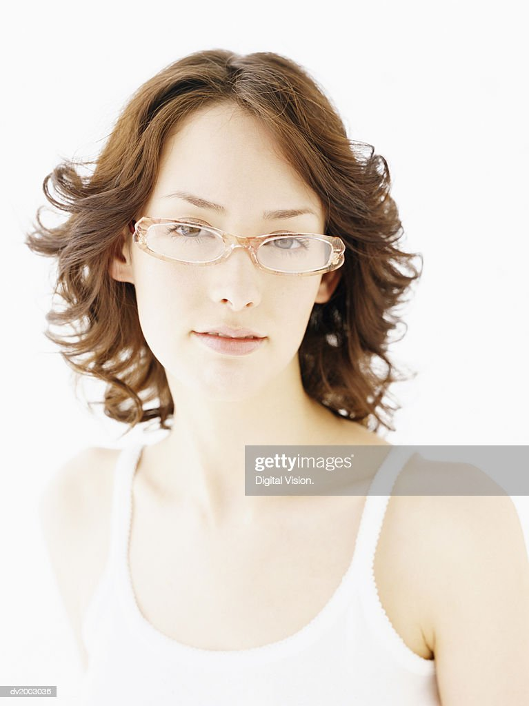 Studio Portrait of a Woman Wearing Glasses and a White Vest : Stock Photo