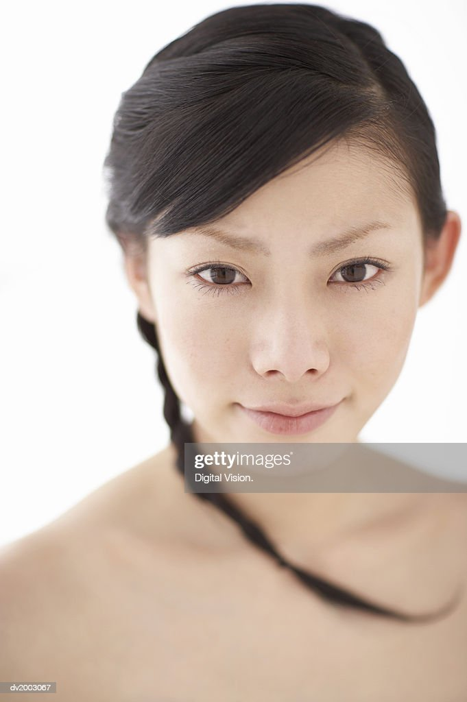 Studio Portrait of a Woman With a Braid : Stock Photo