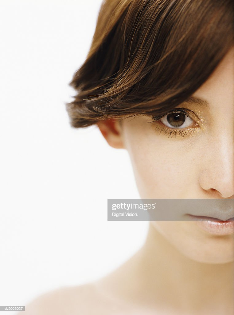 Studio Portrait of a Woman With Glitters Around Her Eyes : Stock Photo