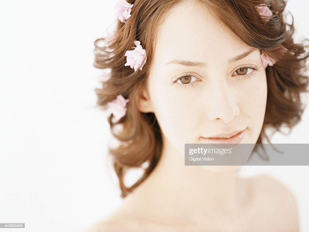 Studio Portrait of a Woman With Rose Petals in Her Hair : Stock Photo