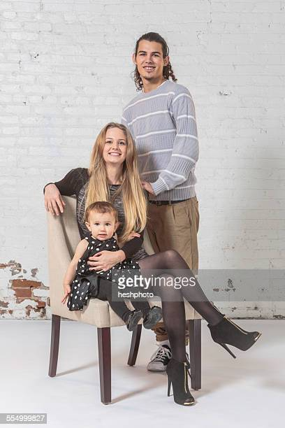 Studio portrait of a young family