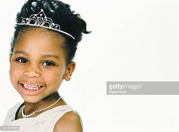 studio portrait of a young girl wearing a tiara and dressed as a princess - princess stock pictures, royalty-free photos & images