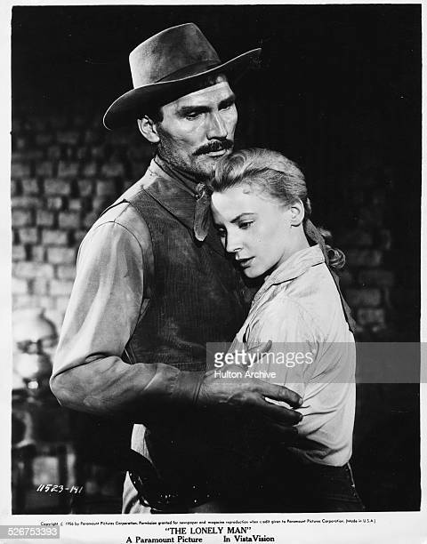 Studio portrait of actors Jack Palance and Elaine Aiken embracing in a scene from the film 'A Lonely Man' for Paramount Pictures 1957