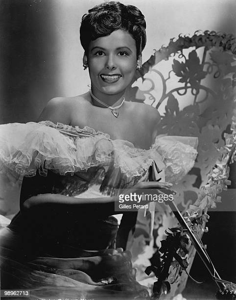 Studio portrait of actress and singer Lena Horne sitting on a chair circa 1940