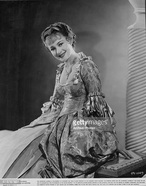 Studio portrait of actress Olivia de Havilland wearing an 18th century formal gown costume circa 1930