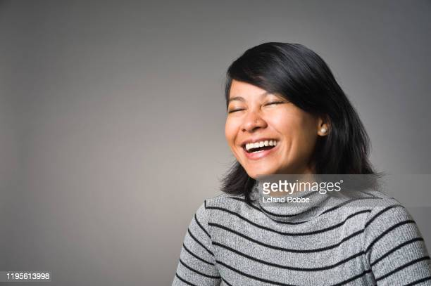 studio portrait of adult filipino woman - one mature woman only stock pictures, royalty-free photos & images