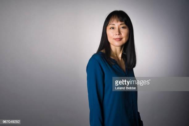 studio portrait of adult japanese woman with long dark hair - 40代 ストックフォトと画像