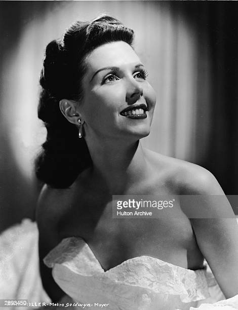 Studio portrait of American actor and dancer Ann Miller in a strapless lace gown and with teardrop earrings circa 1940s