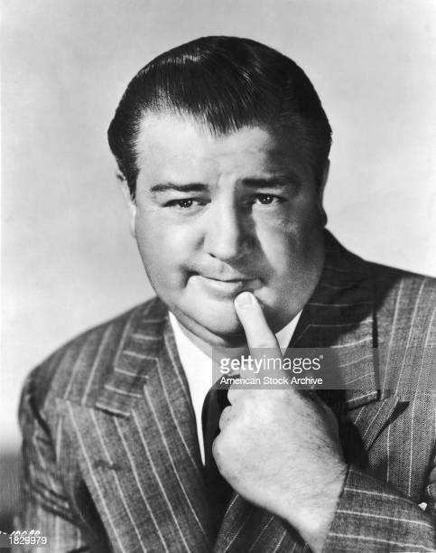 Studio portrait of American comic actor Lou Costello holding his index finger to his chin 1940s