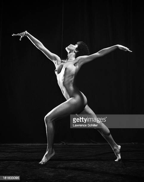 Studio portrait of American dancer and actress Paula Kelly as she poses naked 1969