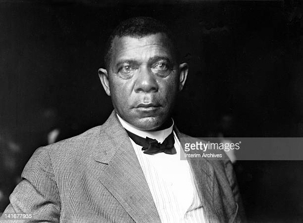 Studio portrait of American educator economist and industrialist Booker T Washington founder of the Tuskegee Institute in Alabama wearing a bow tie...