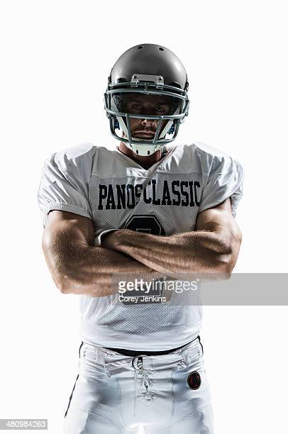 studio portrait of american football player - american football strip stock pictures, royalty-free photos & images
