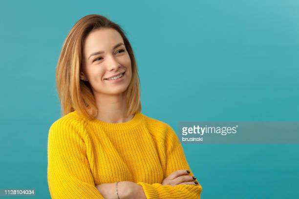 studio portrait of an attractive 20 year old woman - colored background stock pictures, royalty-free photos & images