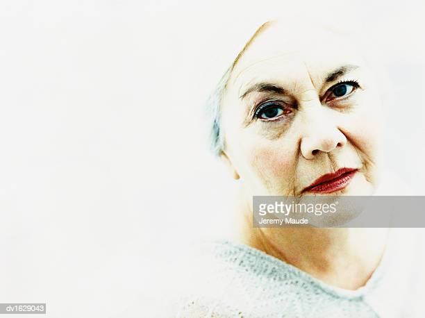 studio portrait of an elderly woman against a white background - overexposed stock pictures, royalty-free photos & images
