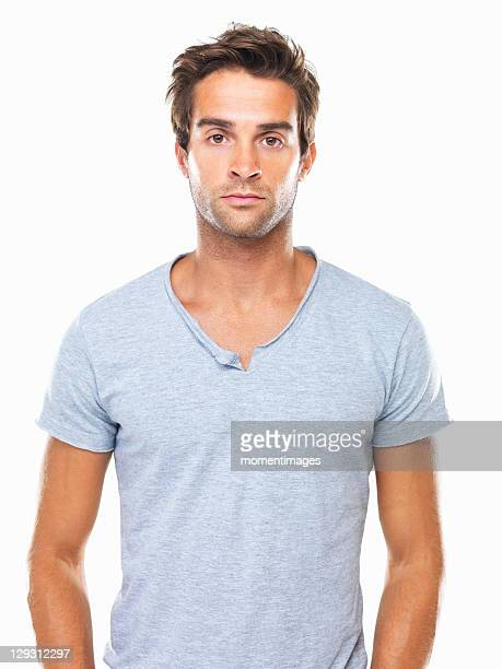 Studio portrait of angry young man flaring nostrils