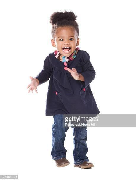 Studio portrait of baby girl (18-23 months) dancing