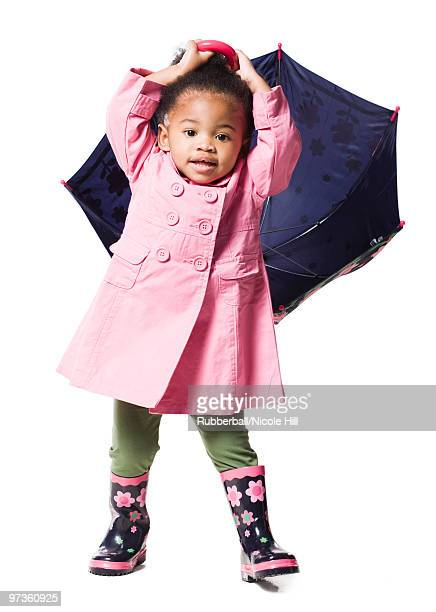 studio portrait of baby girl (18-23 months) holding umbrella - 18 23 months stock pictures, royalty-free photos & images