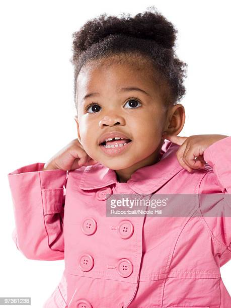 studio portrait of baby girl (18-23 months) wearing pink coat - 18 23 months stock pictures, royalty-free photos & images