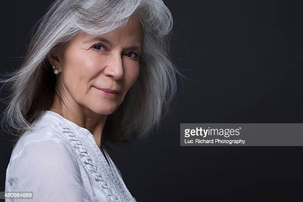 Studio portrait of beautiful senior woman
