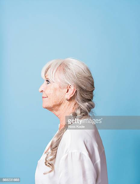 Studio portrait of beautiful senior woman