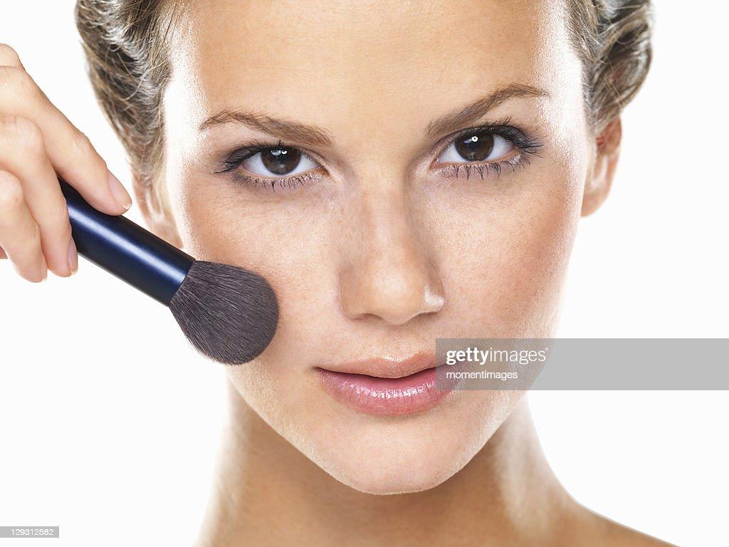 Studio portrait of beautiful woman blushing cheeks : Stock Photo