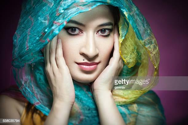 Studio portrait of beautiful woman in dupatta.